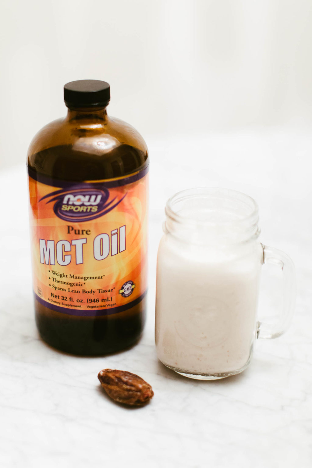 Almond milk blended with medjool dates and MCT Oil. Benefits of MCT Oil include appetite reduction, weight loss, increased energy levels, and improved athletic performance.